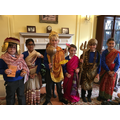 Dressing up as Hindu gods.