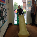 Sliding into nursery while we say goodbye at the door
