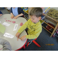 Making playdough letters.
