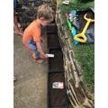 Planting seeds.