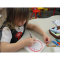 Making our own clocks and telling the time!