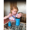 Painting a bird feeder.