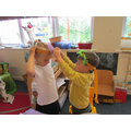 Helping each other to make an Australian flower headdress.