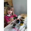 Homemade clay pot painting.