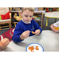 Fruit kebabs with repeating patterns.