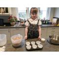 Making birdseed fat cakes.