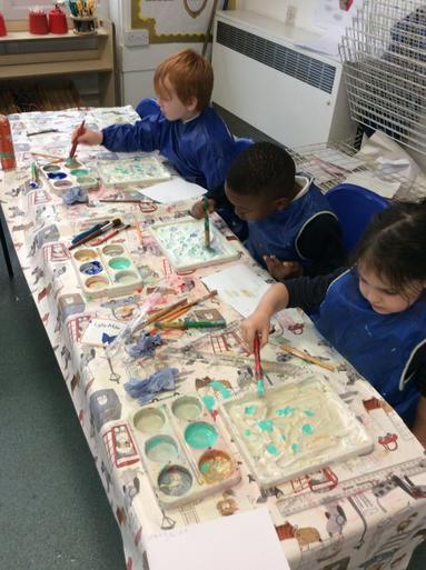 Getting messy with shaving foam to create a marbling effect