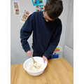 Dylan mixing the salt dough for christmas decorations