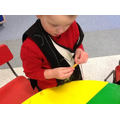 Developing fine motor skills with pasta threading.