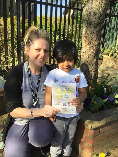 Celebrating Ayaan's reading award. Ayaan has read over 50 books. Well Done Ayaan