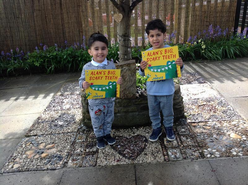Ibrahim and Zakariya receive their book prize for reading fifty books>