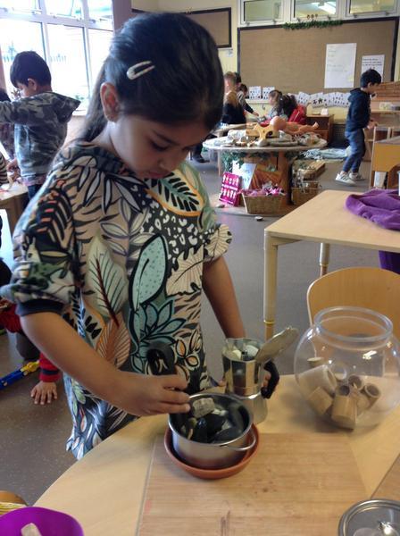 Inaya made chocolate muffins, they cost five dollars