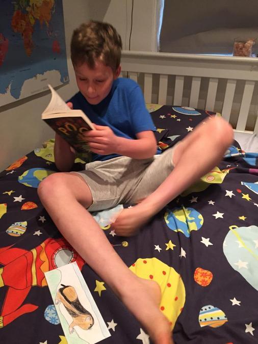Finley enjoying the book Pog.