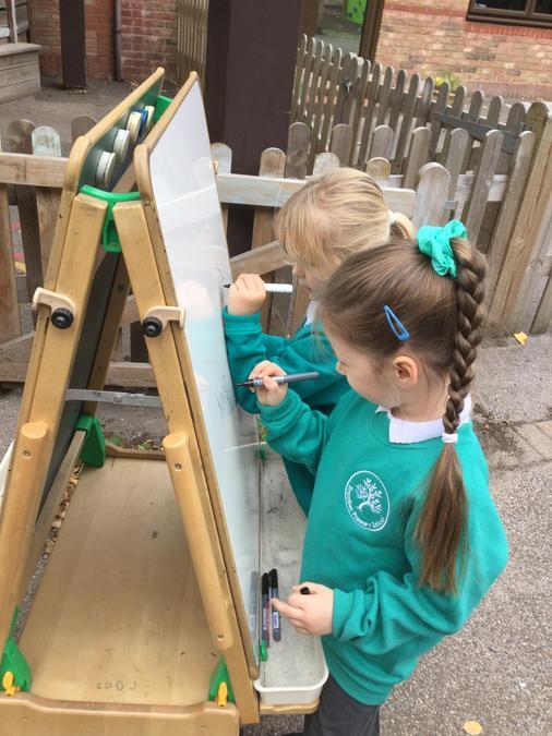Mark making on the whiteboard easel!