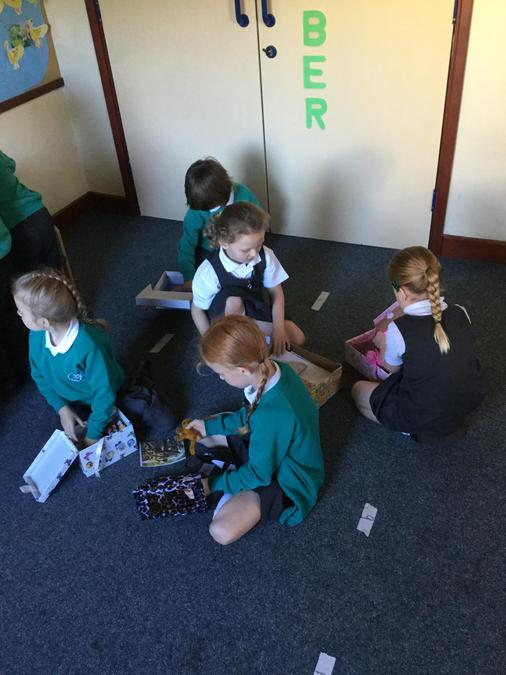 Looking at our boxes with our friends during Playful Learning