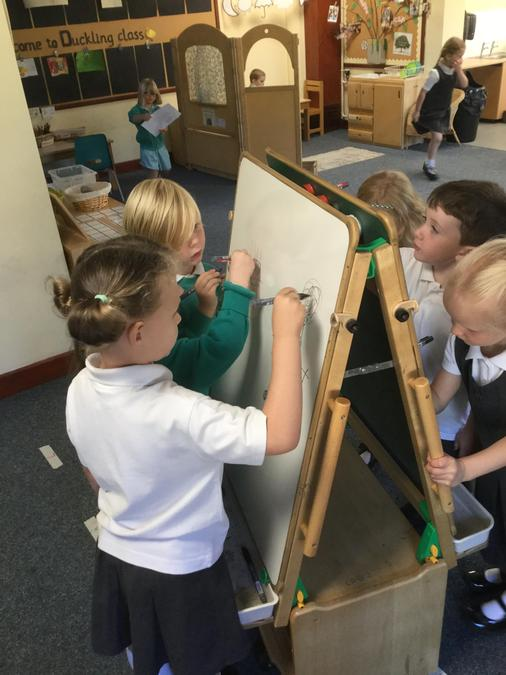 Mark making on the whiteboard easel and sharing with friends!