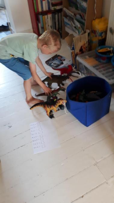 Maths work with dinosaurs, good idea Leo!