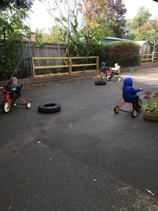 Having fun on the bikes - Taking turns with each other too!