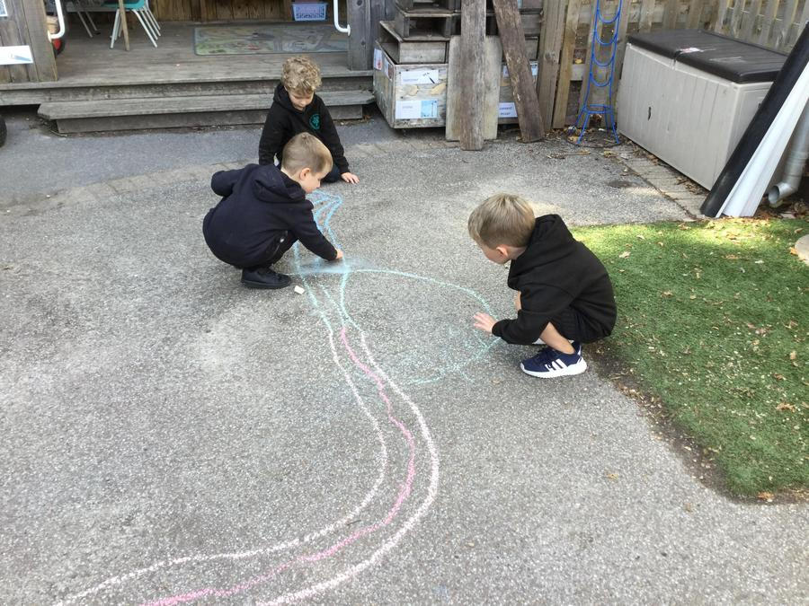 Mark making with the chalks in the outside area