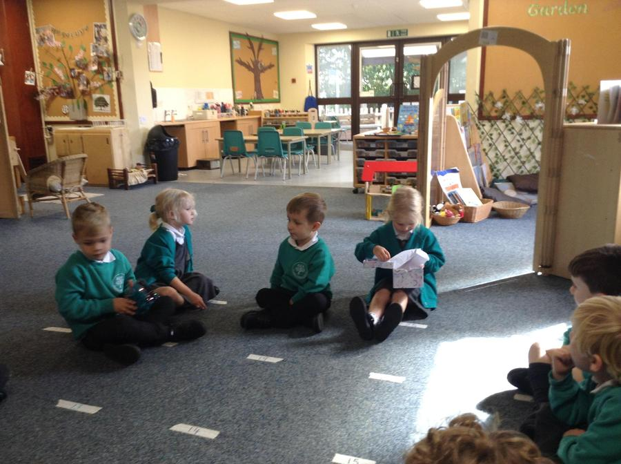 Sharing our 'getting to know me' boxes during circle time