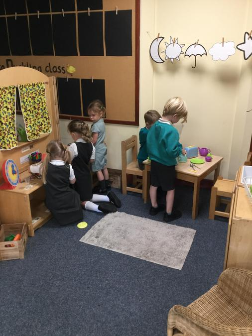 Playing altogether in the home corner!