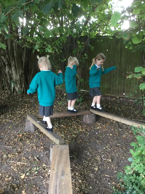 Challenging ourselves on the balancing beams!