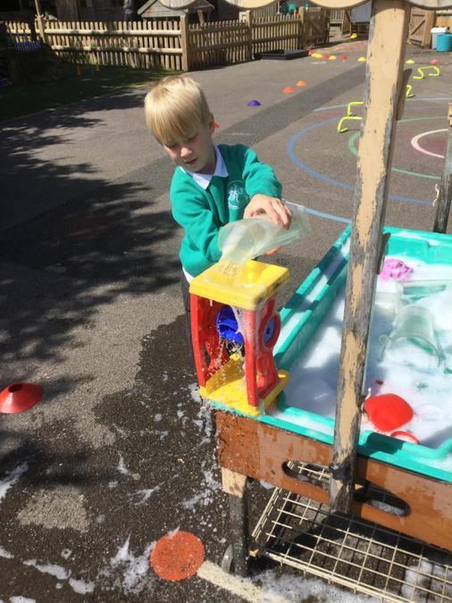 Water play! A good time to practise hand washing!