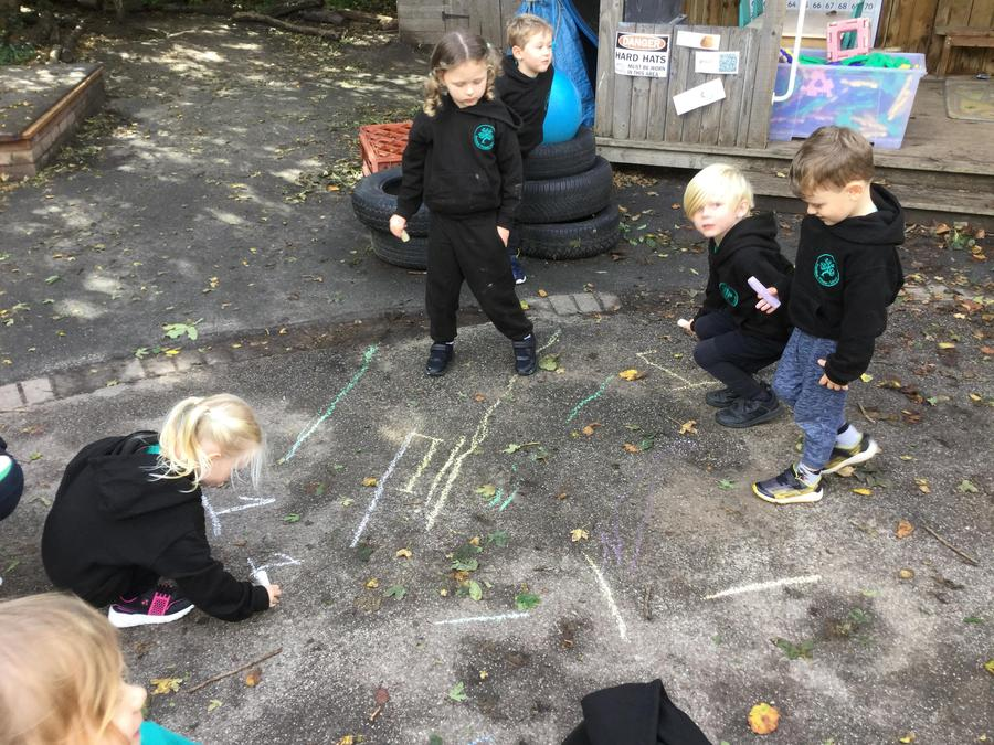 Forming the number 1 with chalk outside!