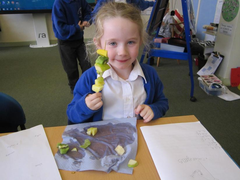 Fruit kebab made by following her own instructions