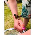 Releasing her butterflies