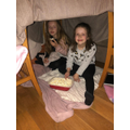 Evie and her sister enjoying some popcorn!