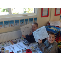 Max and Jack writing their names in Viking runes.