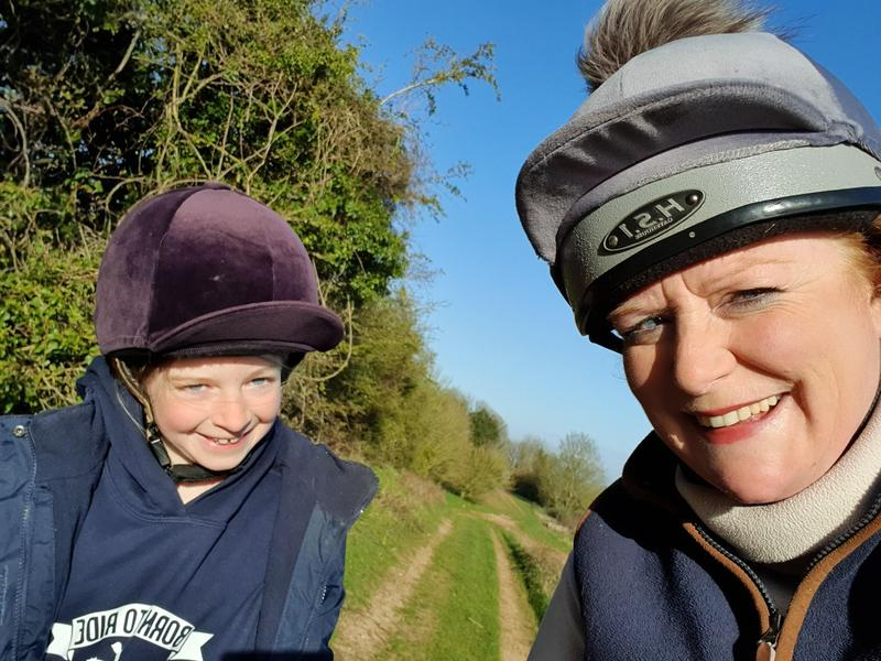 Lily and her mum out on horseback.
