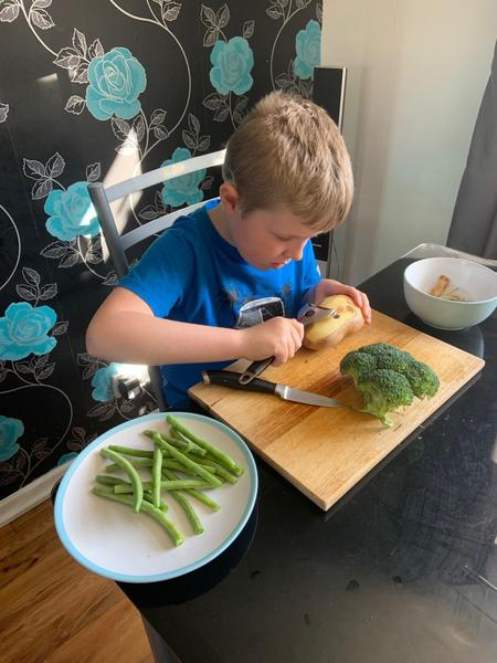 Harrison making a healthy meal for the family.
