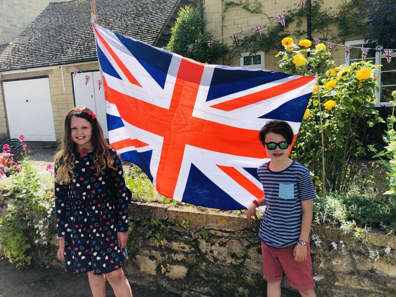 Seb and Olivia proud, next to their Union Jack.