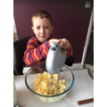Emrys in charge of the electric whisk!