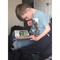 Lucas (Year 4) caught reading at home.