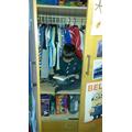 Ben (Year 4) reading in his wardrobe