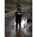 Evie (Year 4) enjoying a book and a muddy walk