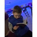 Oscar (Year 2) enjoying a quick read.