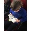 Sienna (Year 5) reading on the bus to swimming