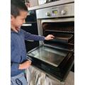 Patrick carefully baking!