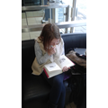 Erin (Year 6) caught reading at the hairdressers.