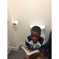 Nana (Year 6) reading on the toilet!