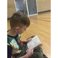 Corbie (Year 4) reading while he waits