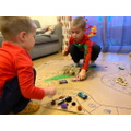 Szymon K and his little brother playing his board game!