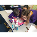 Working together with magnifying glasses