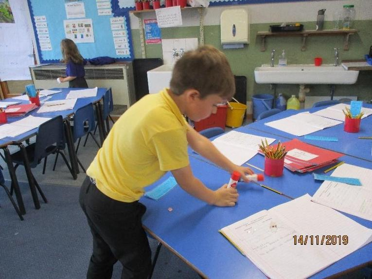 Helping to tidy the classroom