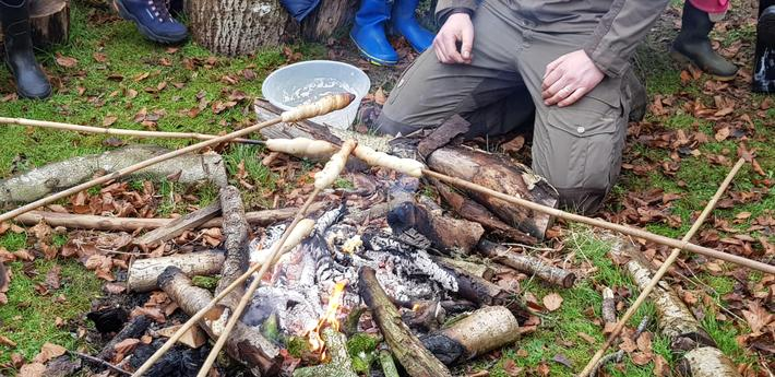 Baking Stone Age bread on the campfire.