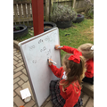 Our rainbow challenges include maths activities in our outdoor area.
